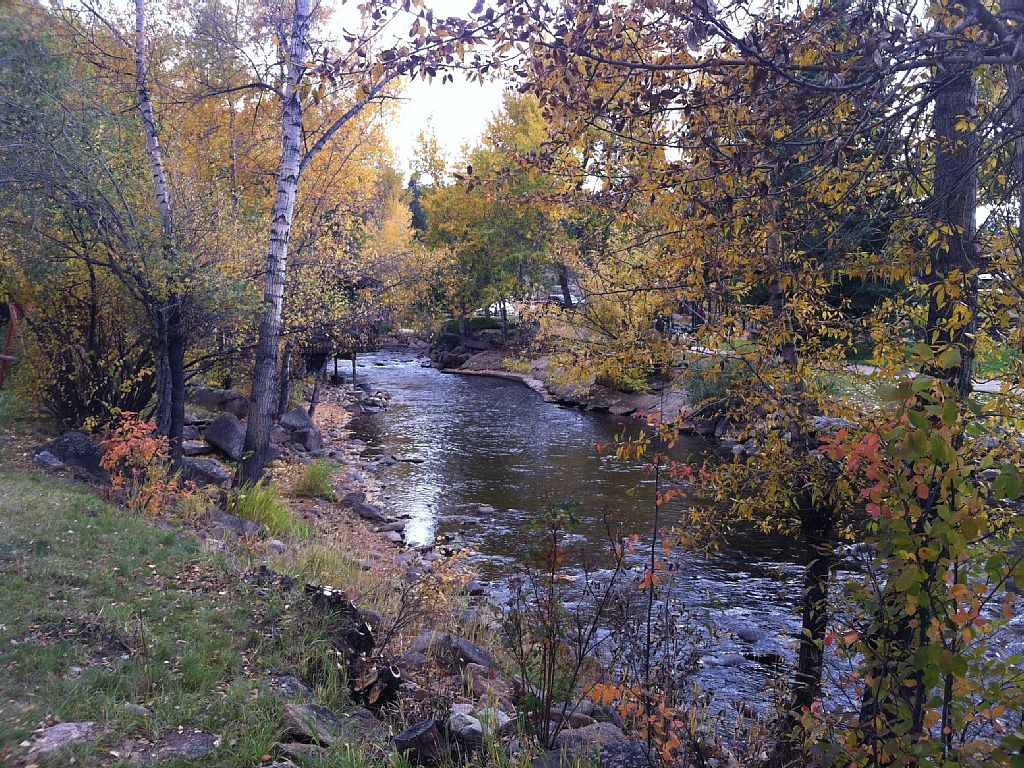 This is an Autumn image of the Big Thompson River along the downtown walk from This Mountain Life Basecamp and Vacation Rental Cabins
