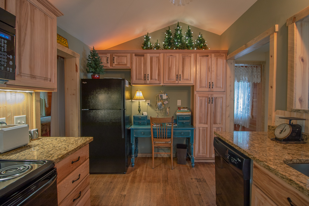 Redemption Cabin is an extraordinary vacation rental cabin near RMNP in Estes Park CO USA. This is an image of its kitchen.