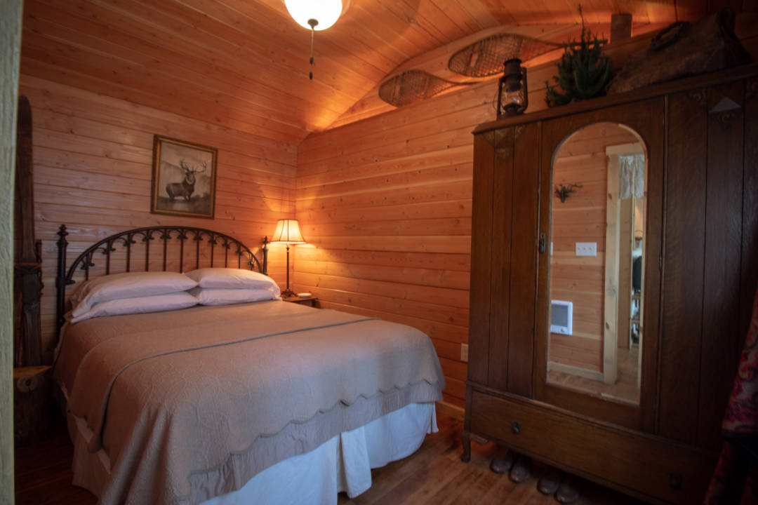 Redemption Cabin is an extraordinary vacation rental cabin near RMNP in Estes Park CO USA. This is an image of its front bedroom.