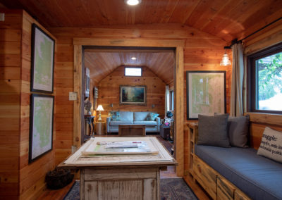 This is an image of Exploration Cabin's Map Room into the Living Room.