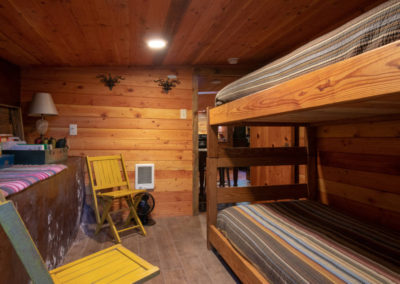 Storybook Exploration Cabin is an Extraordinary Mountain Town Vacation Home in Estes Park CO USA near Rocky Mountain National Park. This is an image of the Bunk Room.