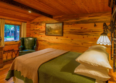 Exploration Cabin is an extraordinary Mountain Town vacation rental in Estes Park Co near Rocky Mountain National Park. This is an image of its front bedroom.