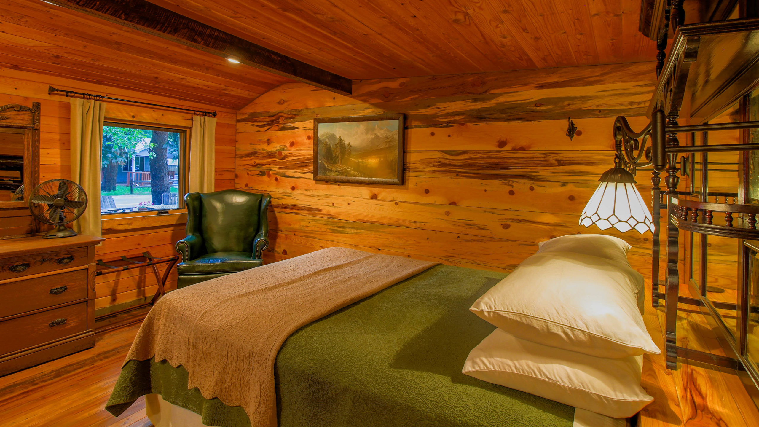 Storybook Exploration Cabin is an Extraordinary Mountain Town Vacation Home in Estes Park CO near Rocky Mountain National Park. This is an image of the front bedroom.