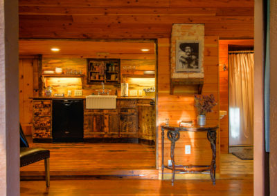 Storybook Exploration Cabin is an Extraordinary Mountain Town Vacation Home in Estes Park CO near Rocky Mountain National Park. This is an image looking in from the front door.