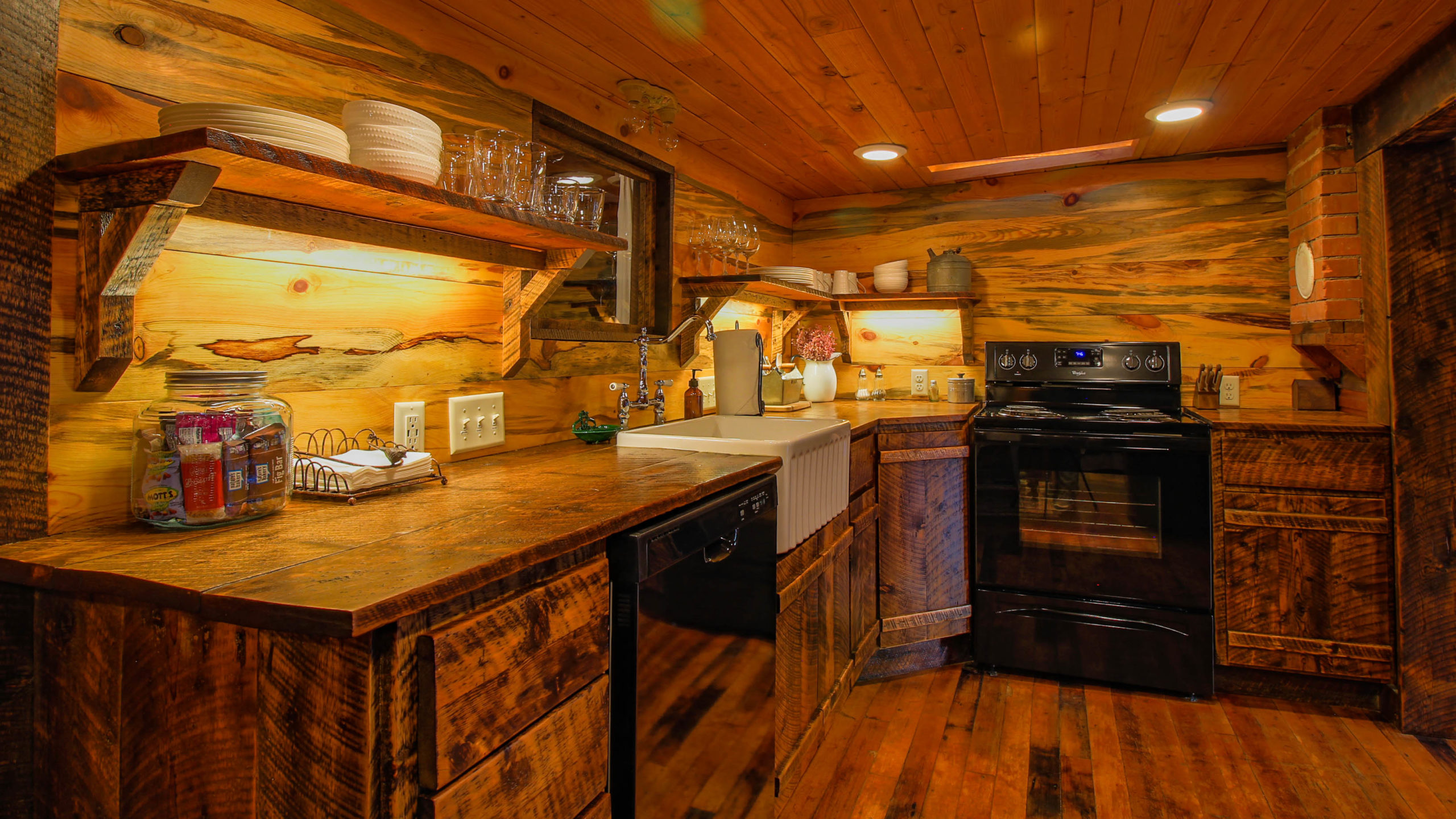 Storybook Exploration Cabin is an Extraordinary Mountain Town Vacation Home in Estes Park CO near Rocky Mountain National Park. This is an image of the kitchen.