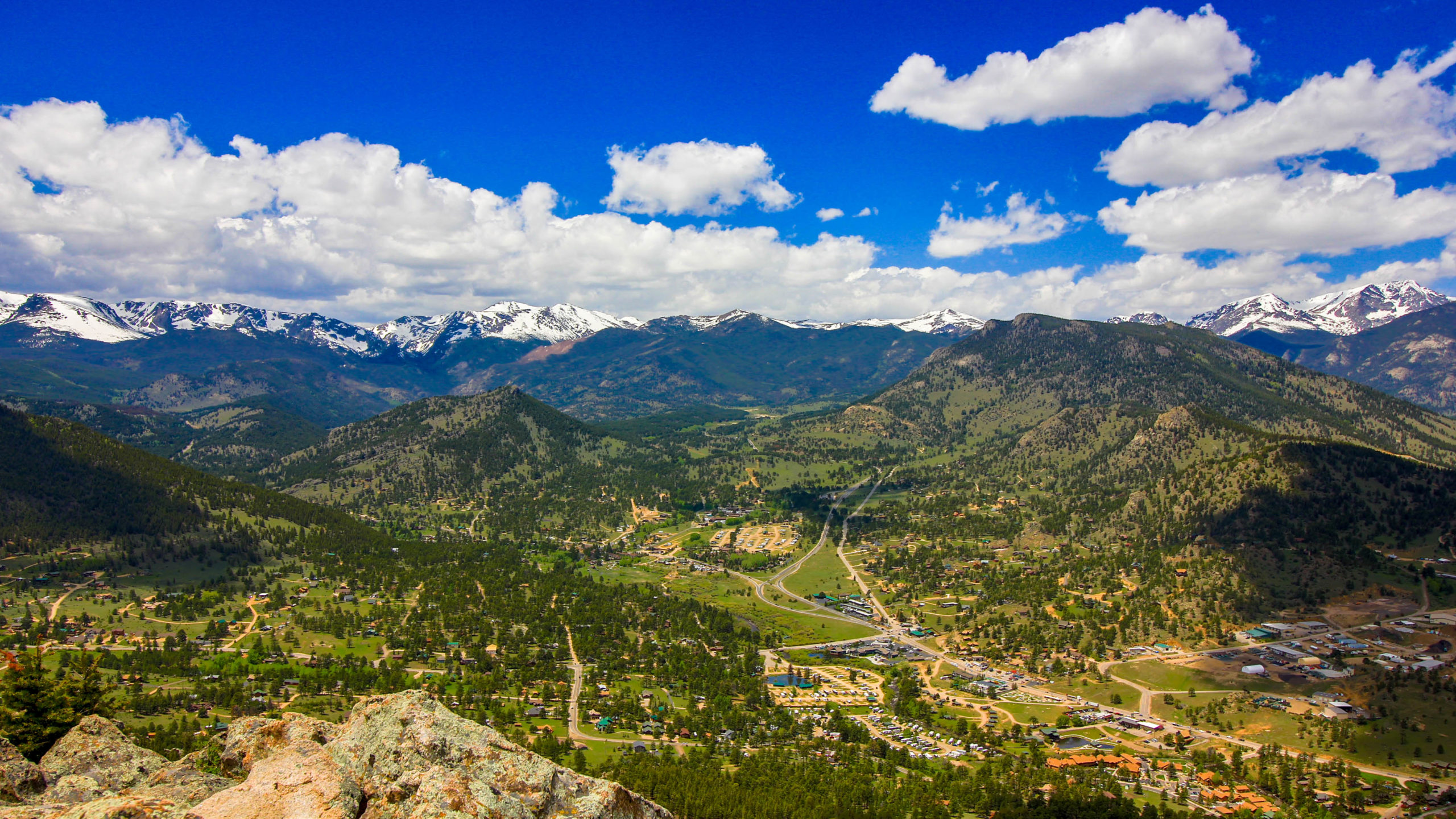 This is an aerial image looking west up to Beaver Meadows Entrance into Rocky Mountain National Park. This main entrance into the park is less than 3 miles away from This Mountain Life Basecamp.
