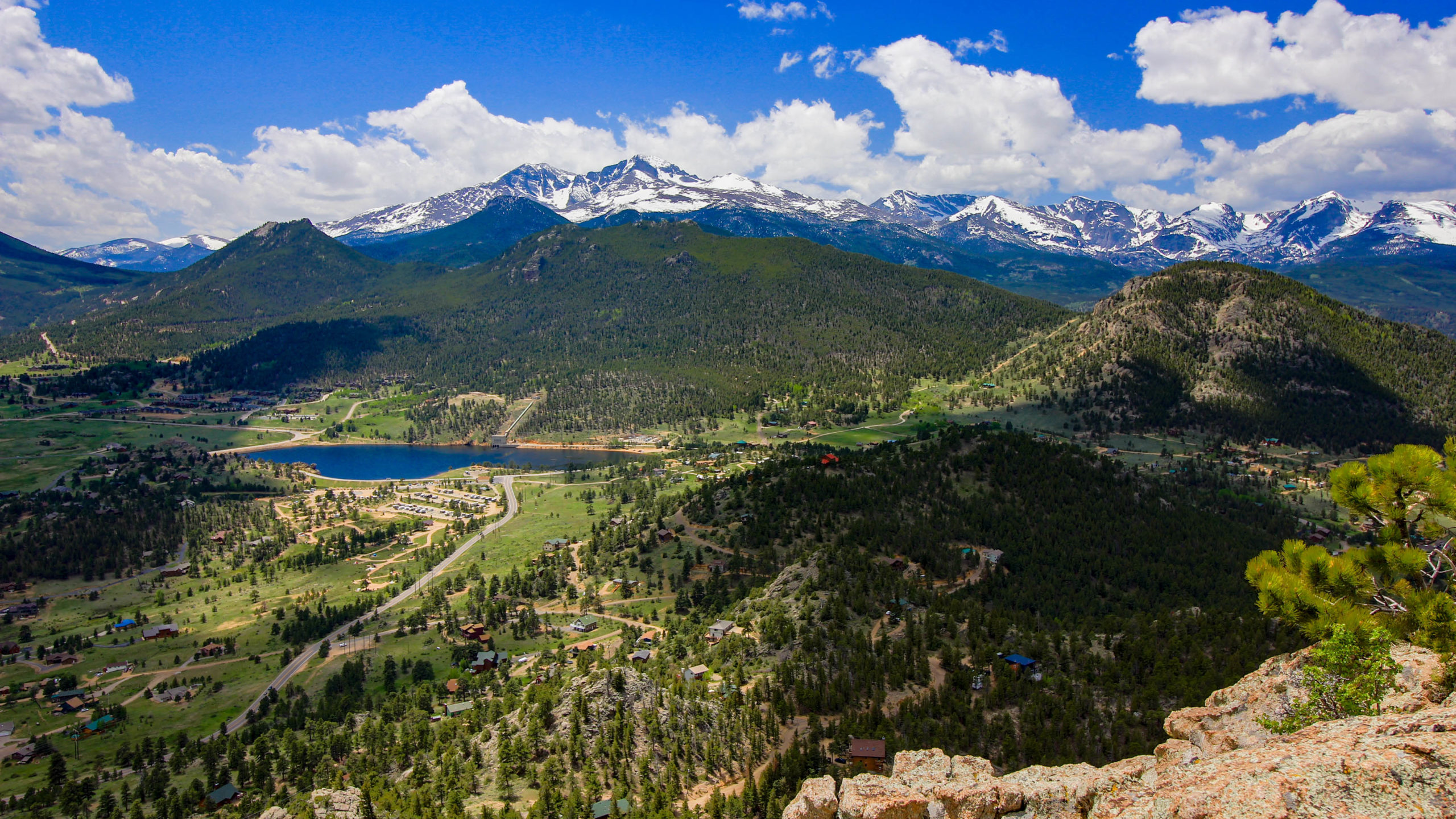This is an image from higher up over Prospect Mountain looking south to southwest showing Marys Lake, Lilly Mountain, the Indian Peaks, Estes Cone, Mount Meeker, Longs Peak, Pagoda Mountain, Chiefs Head, Powell Mountain, Taylor Peak, Otis Peak, Hallet Peak and Flattop Mountain at the extreme right with Giant Track in its foreground.