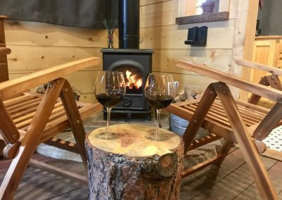 This is an image of Reflection Cabin's front studio room fireplace. Reflection Cabin is an Extraordinary Mountain Town Vacation Rental in Estes Park CO near Rocky Mountain National Park.